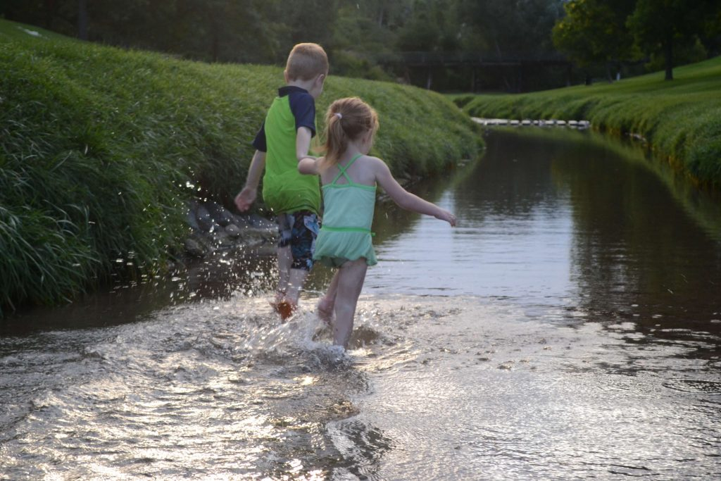 playing in the river while camping