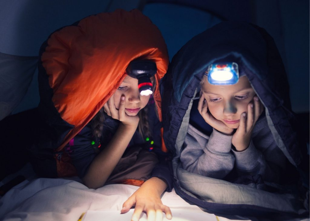 kids with headlamp in tent