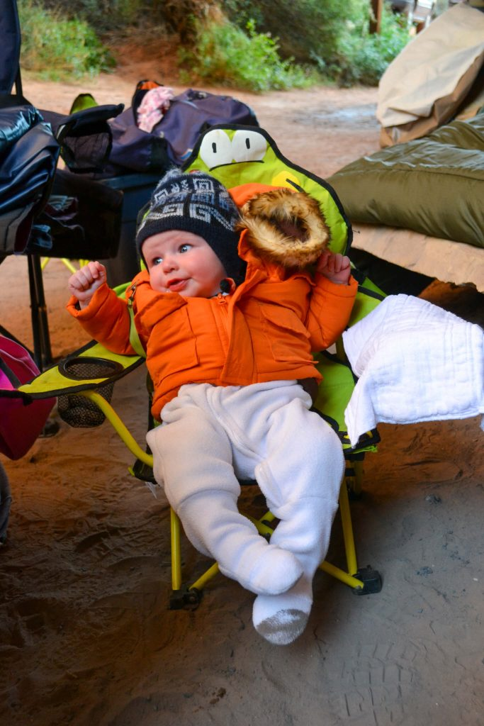 baby dressed warm for camping