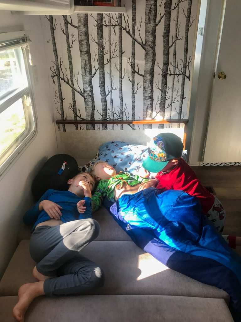 boys camping in trailer
