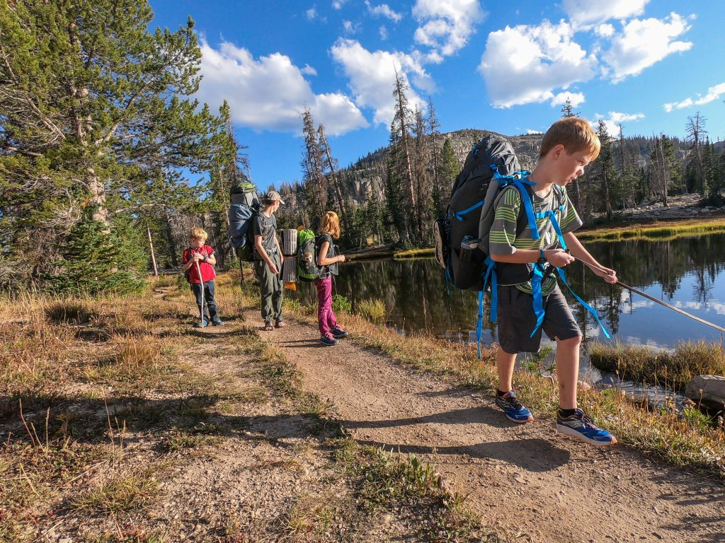 family backpacking with young kids