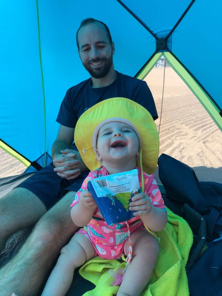 baby girl camping in heat
